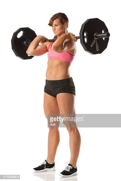 Female athlete weightlifting with barbell