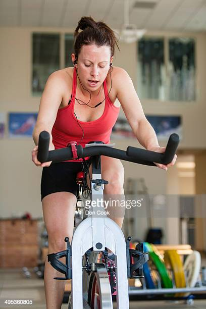 Female Olympic athlete working out in a gym.