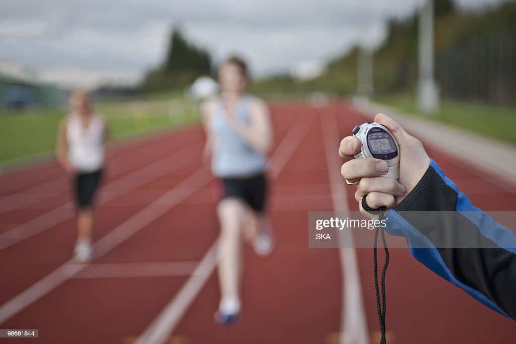 2 female athletes and stopwatch : Stock Photo
