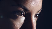 An extreme close up of a female athletes brown eyes, heavily focused on her mission.