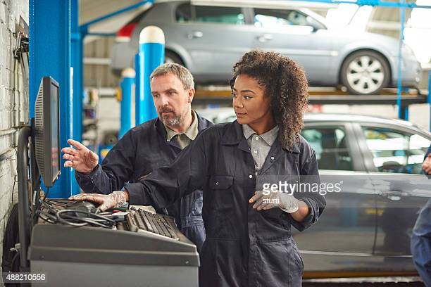 female auto mechanic with her boss