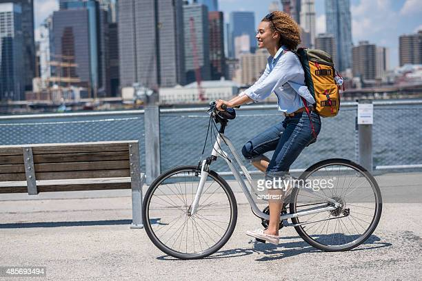 Female backpacker riding a bike in New York