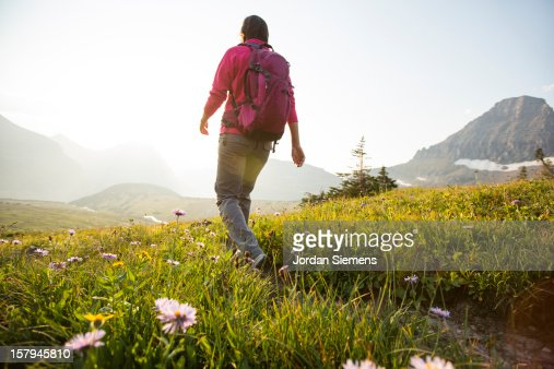 A female backpacking in the mountains. : Stock Photo