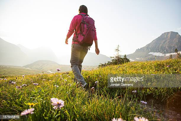 A female backpacking in the mountains.