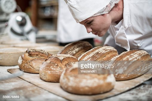 Female baker smelling fresh bread