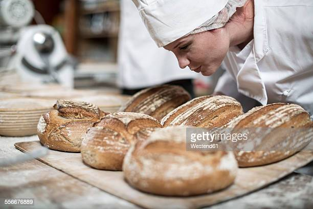 Female baker smelling fresh bread