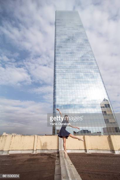 Female ballet dancer dancing on a rooftop in Lyon, France