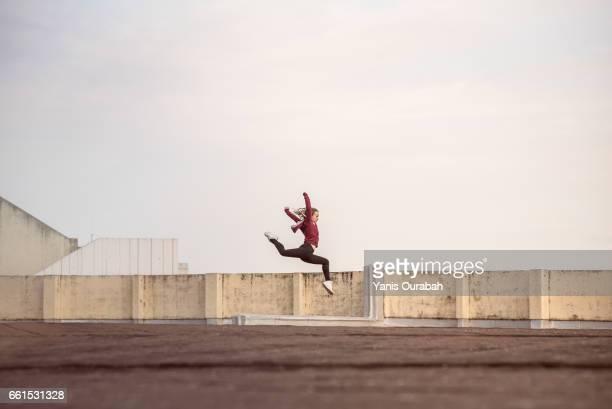 Female ballet dancer dancing on a rooftop in Lyon, France