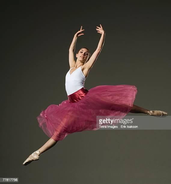 Female ballet dancer jumping
