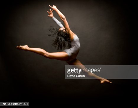 Female ballet dancer leaping in air : Stock Photo