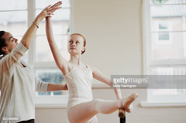 Female ballet dancer perfecting pose