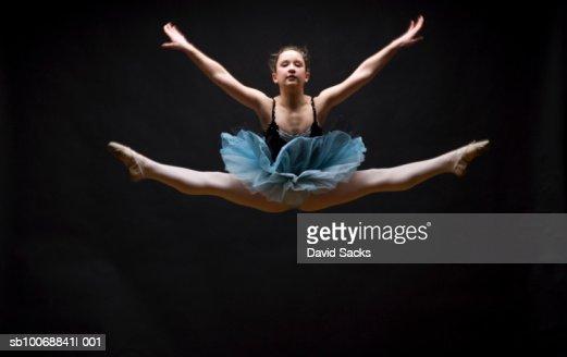 Female ballet dancer performing splits in air