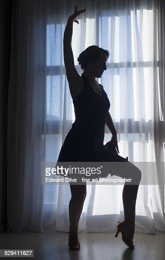 Female ballroom dancer in dance studio silhouette