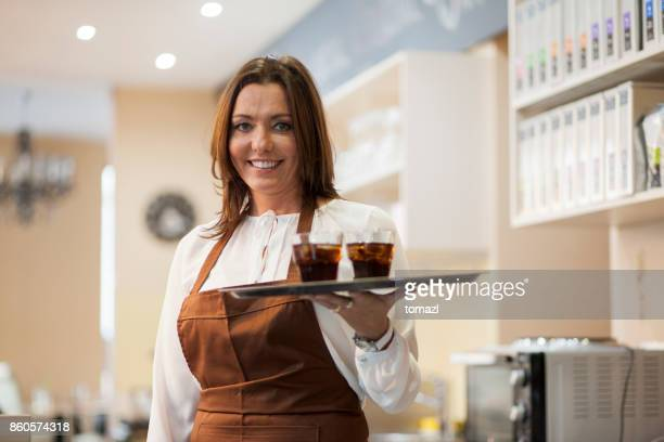 Female barista serving drinks