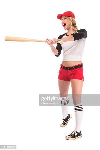 Female Baseball batter watching where she hit the ball