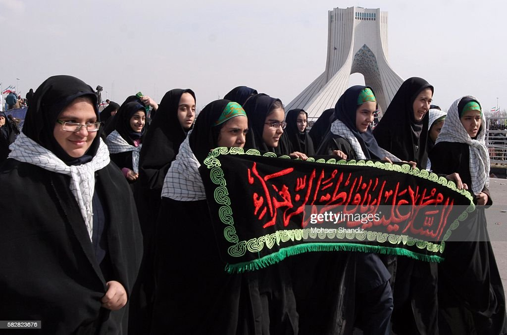 Female Basiji girls march in Azadi Square while Iranians mark the 28th anniversary of the victory of their Islamic Revolution with nationwide rallies...