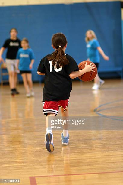 A female basketball player in school