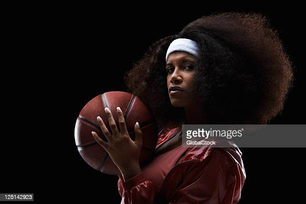 Female basketball player on black background