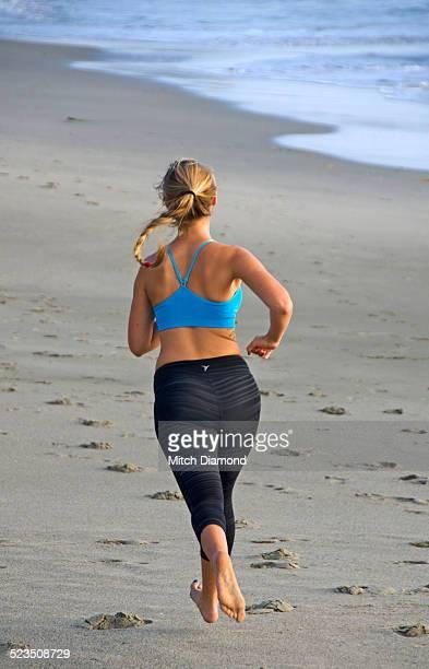 Female beach jogger