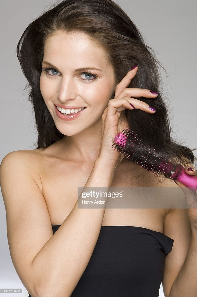 female beauty brushing hair