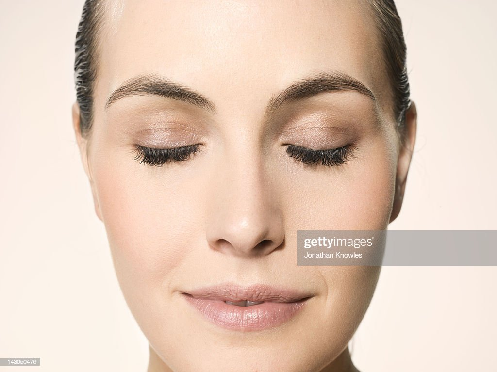 Female beauty, close up on face, eyes closed : Stock Photo