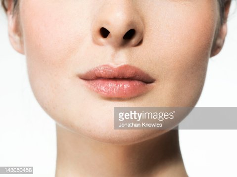 Female beauty, close up on lips, natural : Stock Photo
