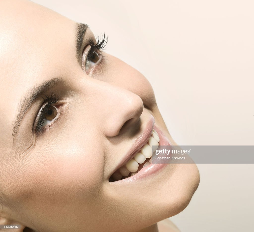 Female beauty, side view, smiling : Stock Photo