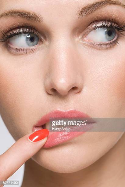 female beauty with finger in mouth