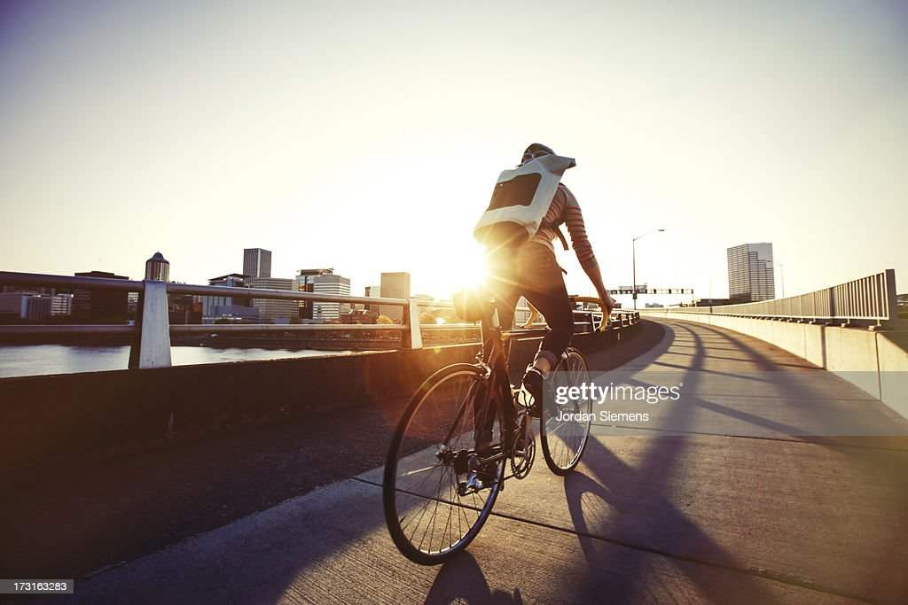 A female bike commuting. : Stock Photo