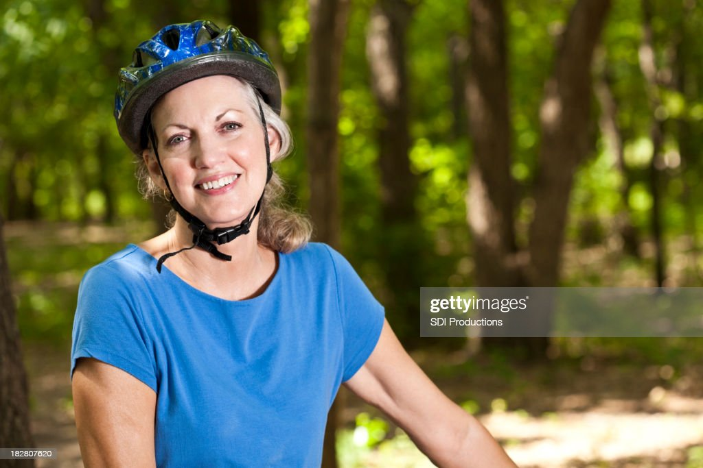 Mature Adult Bike Rider Smiling With Copy Space : Stock Photo