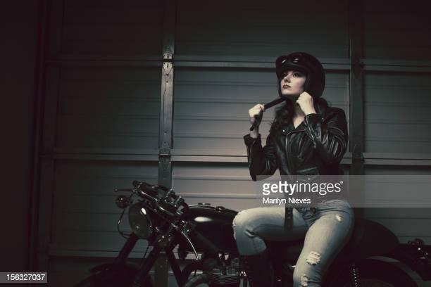 female biker fastening helmet