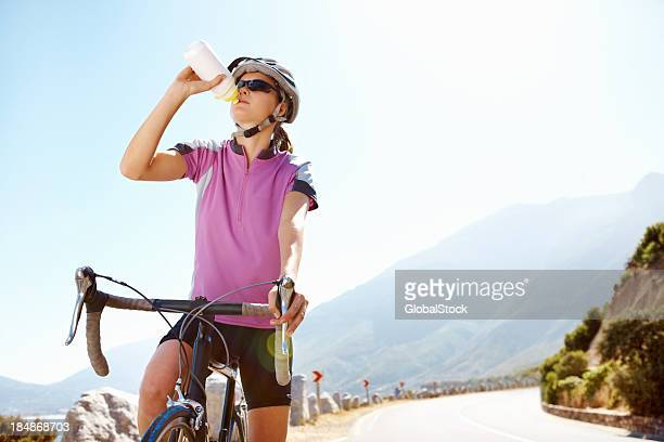 Female biker taking a break