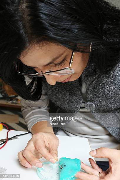 female bioengineer testing a 3d printed sensor