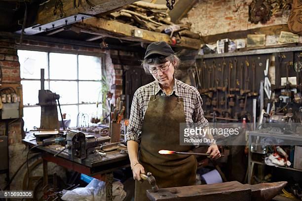 Female blacksmith in her forge