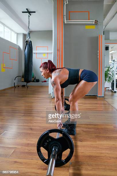 Female bodybuilder training for weightlifting at the gym
