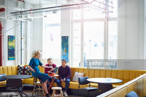 Female boss having informal meeting with colleague