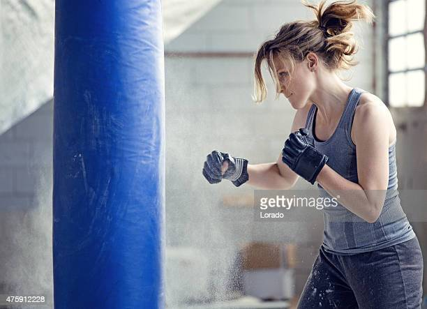 Female boxer in an abandoned warehouse