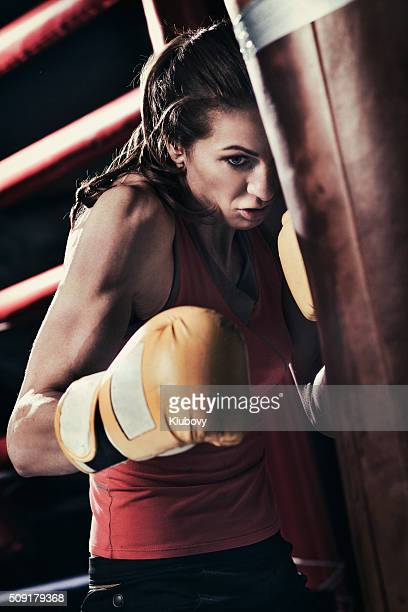 Female boxer training with a punching bag