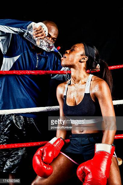 Female Boxer with Coach in the Ring