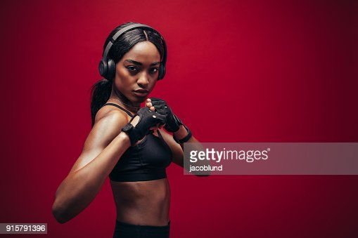 Female boxer with fighting stance : Stock Photo