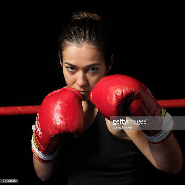 Female boxer with gloves up, portrait