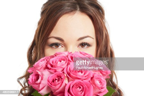 Female bride holding a wedding bouquet of pink roses : Stock Photo