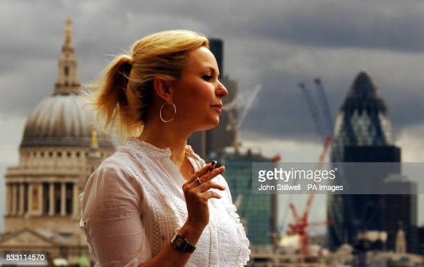 A female British American Tobacco employee takes a cigarette break in the company's new rooftop smokers area at Globe House in the City of London...