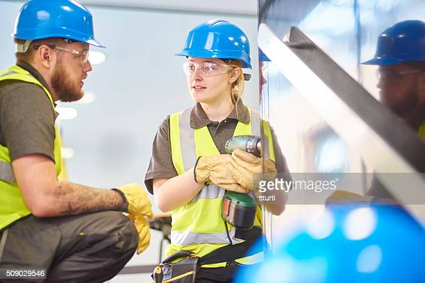 female builder apprentice and colleague