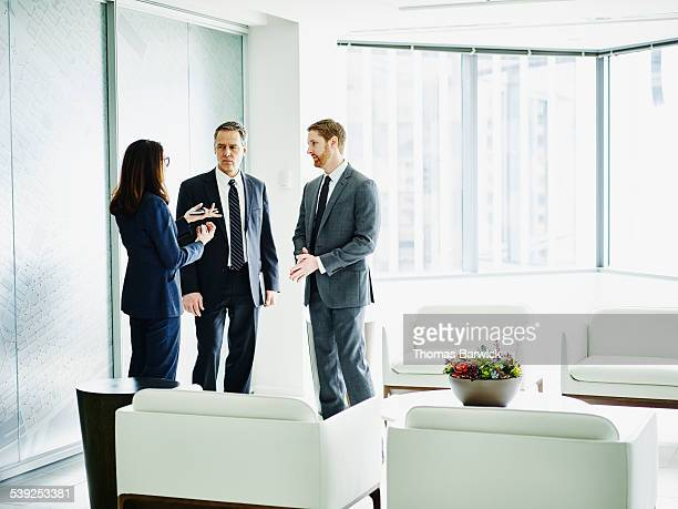 Female business executive leading team discussion