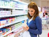 Female buying milk in supermarket
