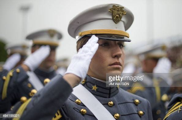 A female cadet salutes as US President Barack Obama arrives deliver the commencement address to the 2014 graduating class at the United States...