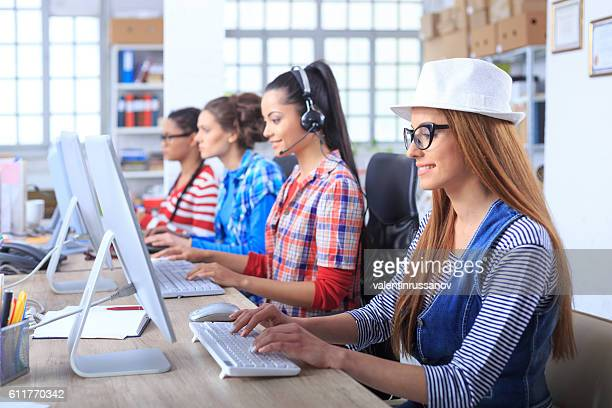 Female call centre team at workplace