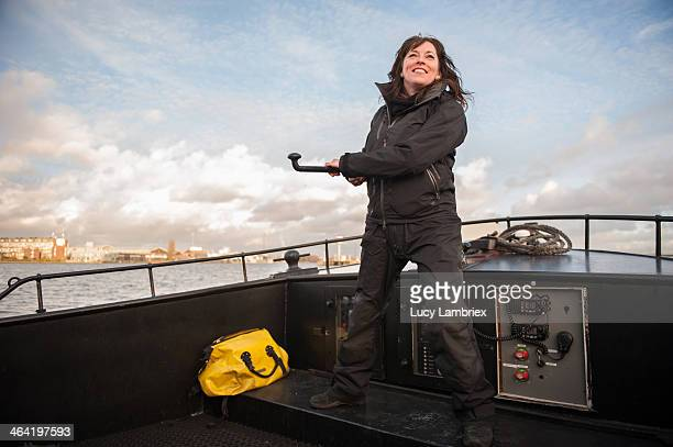 Female captain at the helm of a ship