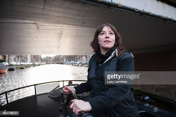 Female captain passing a low bridge